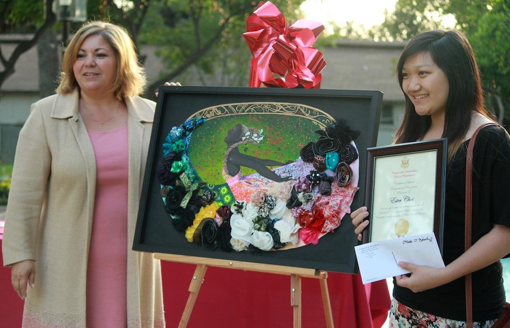 First place winner Esther Choi accepting her award from Congresswoman Linda Sanchez.
