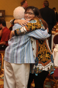 Award winner Sandra Hahn hugging an attendee prior to the ceremony.