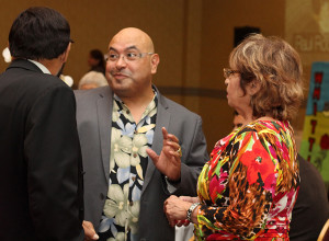 Chairman Roberto Chavez conversing with one of the award winners, Raul Rodriguez.