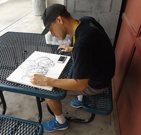 Aaron Smith works on a drawing in between classes. (Crystian Mendoza/El Paisano)