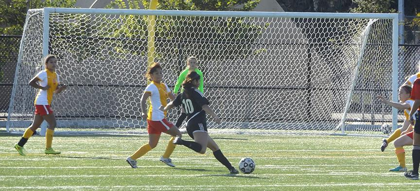 Genesis Patino #10 drives towards opposition then gets a great shot on goal vs Desert.