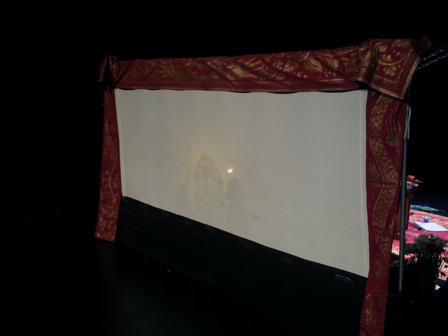 The+linen+cloth+that+serves+as+the+canvas+for+the+shadow+puppets%2C+which+are+cast+by+placing+a+light+bulb+behind+it.