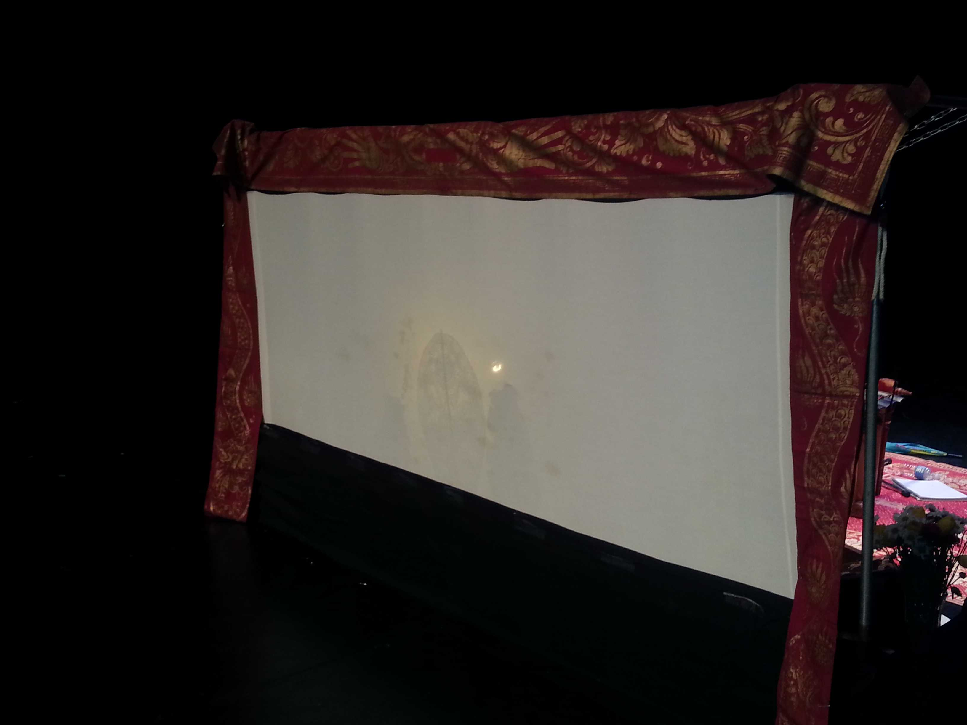 The linen cloth that serves as the canvas for the shadow puppets, which are cast by placing a light bulb behind it.