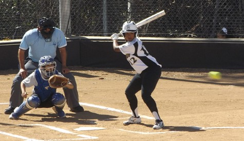 In-fielder Mylene Valencia anticipates the fast approaching ball as she prepares to swing against San Bernardino Valley.