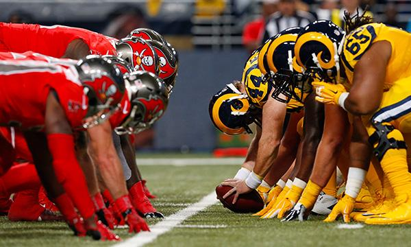 Buccaneers' and Rams' linemen ready to battle in week 15 of the 2015 NFL season. They go at it again this Sunday in Tampa Bay.