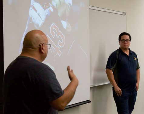Professor Roberto Chavez and Robert Huskey discuss sports photography.