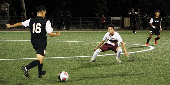 Luis Munoz of Rio Hondo College carries the ball up past a few defenders before switching the ball to #7 forward, Nicholas Knapp who raised his hand to call for the ball against Pasadena City College Oct. 4.