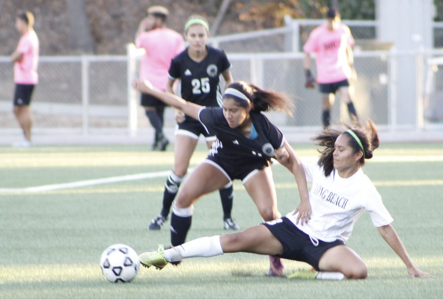 Rio women's soccer player Samantha Garcia goes hard in for a 50/50 challenge against an LBCC opponent who was forced to make a slide tackle in order to try and retain possession Oct. 21.