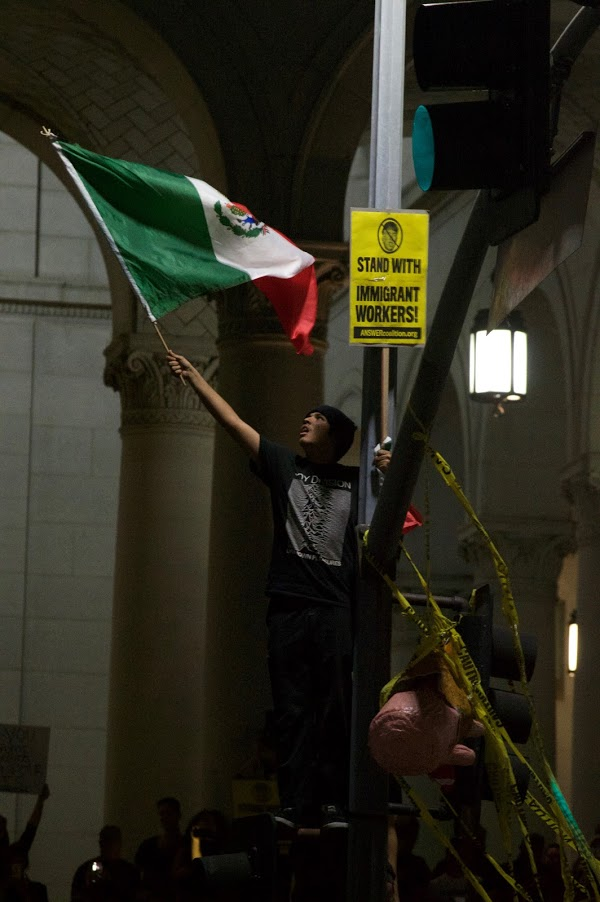 A Trump protester shows pride for the Mexican flag and shows his support for immigrant workers in front of Los Angeles City Hall Nov. 9 in response to the President Elect's win.