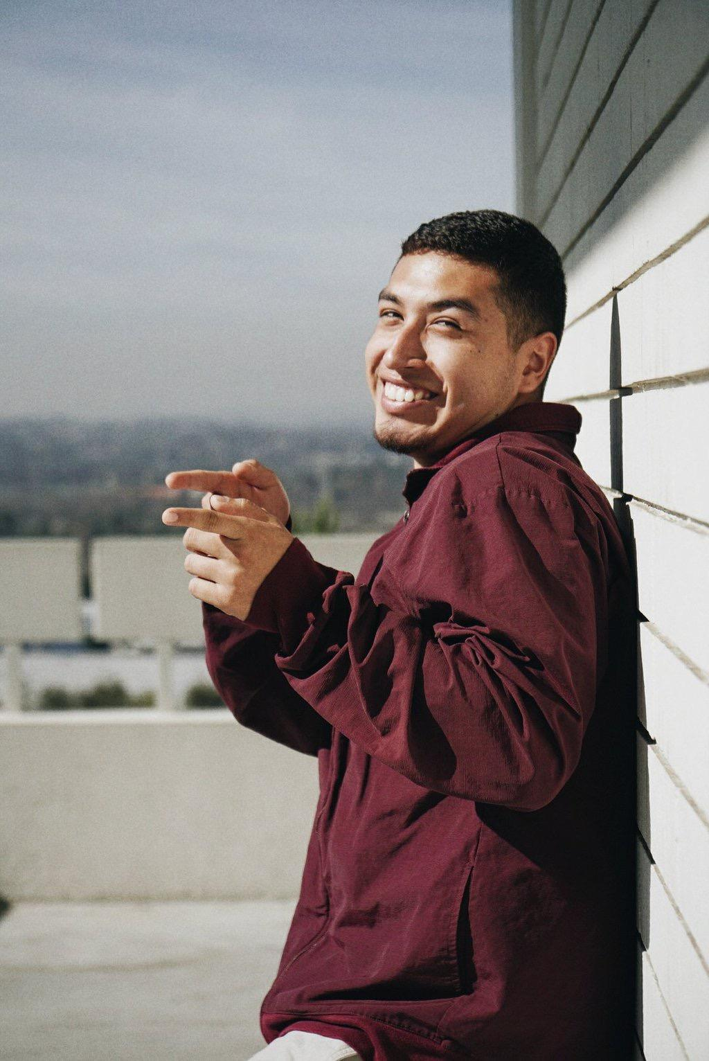 Freddy Vasquez shows off his bright smile  on campus where he promotes most of his music.