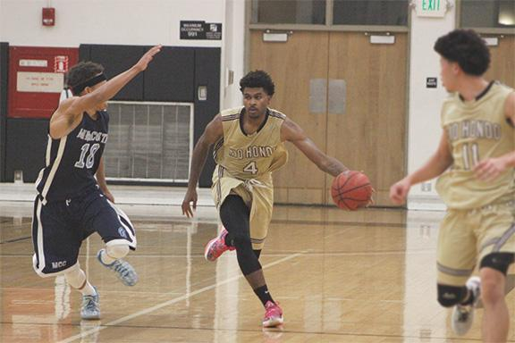 Rio Hondo guard DeShaun Carr dribbles past a MiraCosta College defender. Carr tallied 10 points, four rebounds, and two assists in the game Nov. 10.