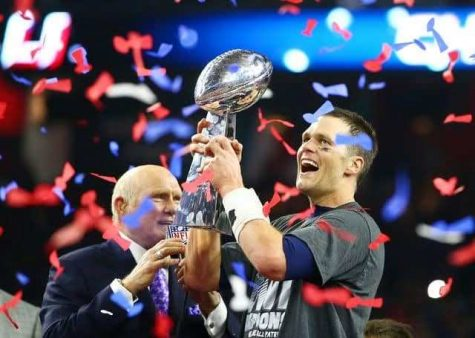 Tom Brady holds Super Bowl Trophy