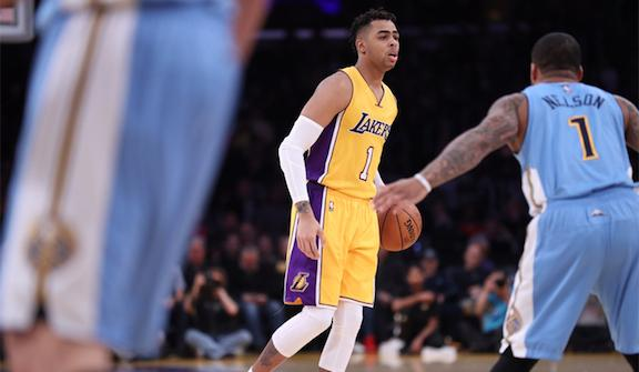 D'Angelo Russell of the Lakers, pictured, returned to action Tuesday night after missing the previous three games with a calf injury. Russell set his career high in assists, with 10 to go along with his 22 points.