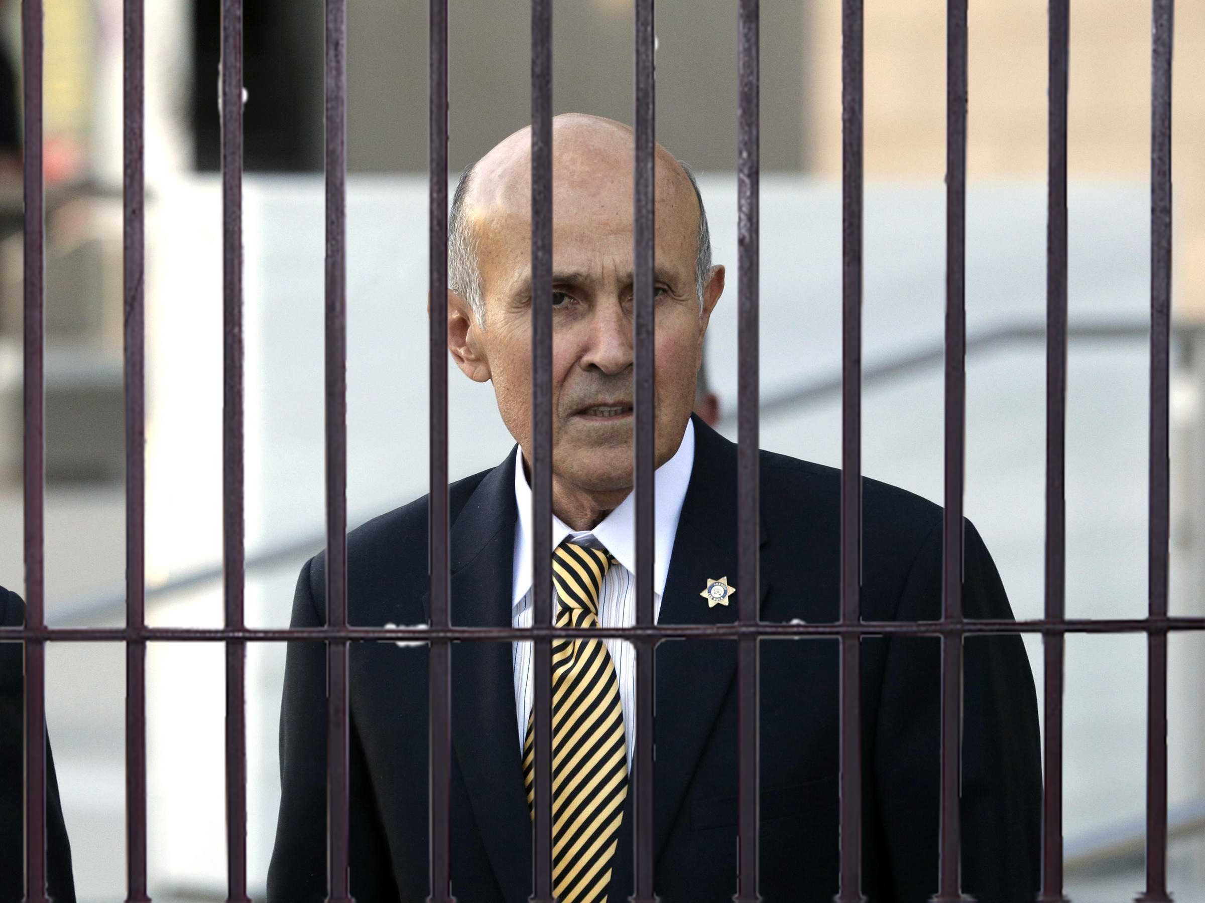 Former Los Angeles County Sheriff Lee Baca leaves federal court in Los Angeles on Monday.