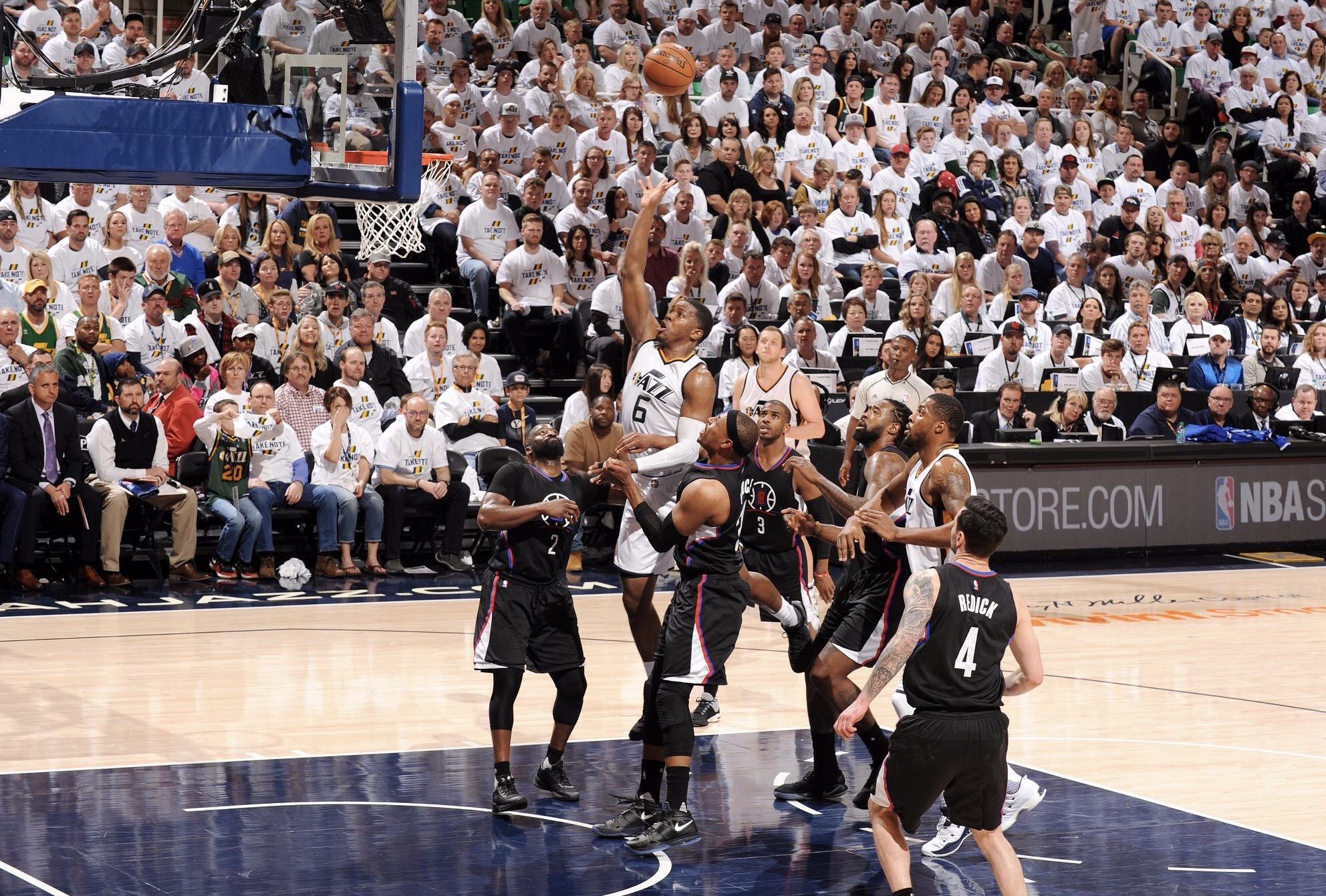 Joe Johnson of the Jazz rises over Clippers' defenders for a floater in Sunday night's game.