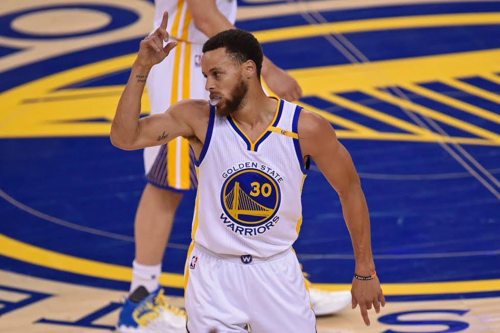 Steph+Curry+points+to+the+sky+during+game+two+of+the+Western+Conference+Finals+at+Oracle+Arena.