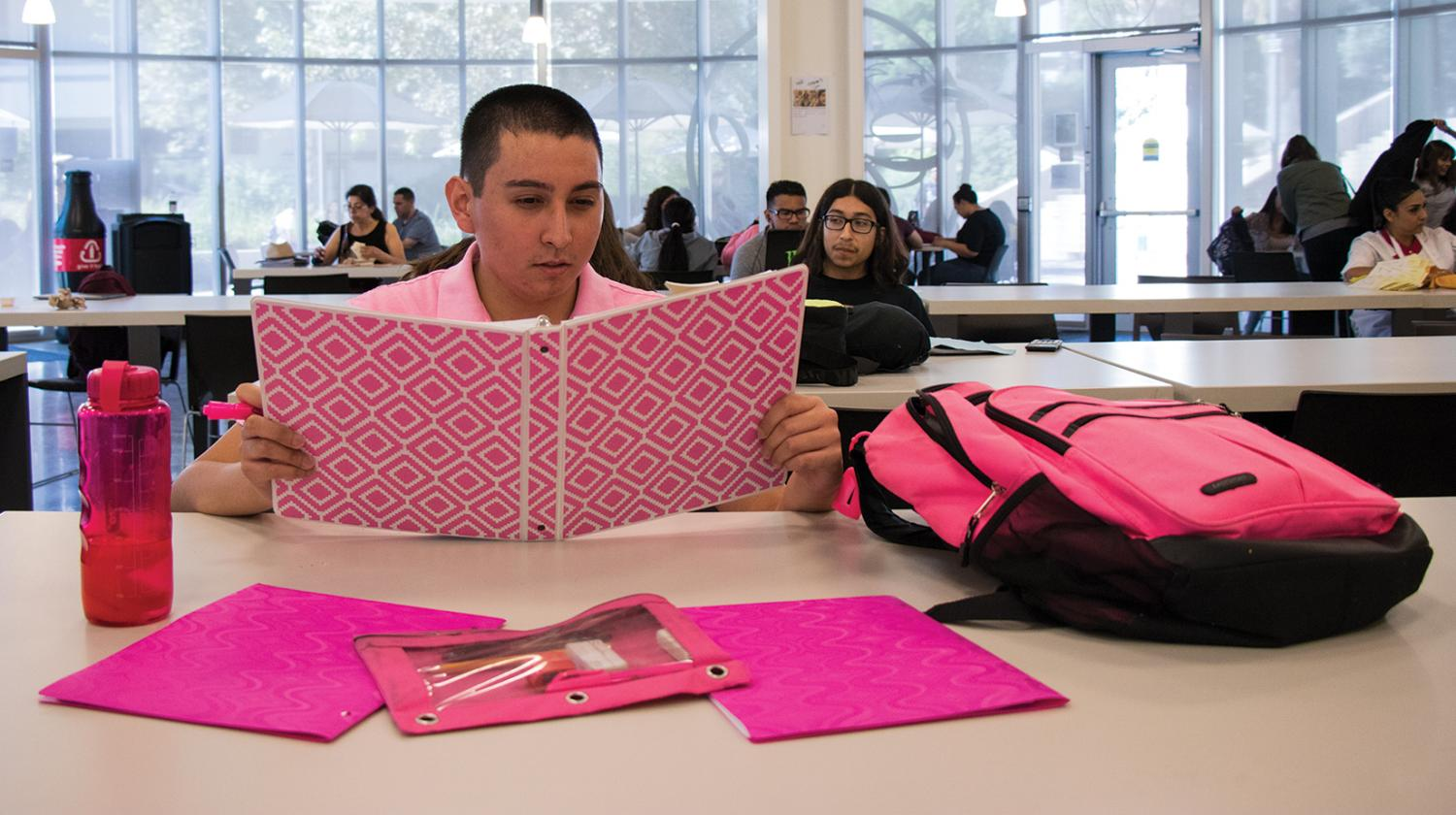 Michael Medrano shows off his pink aesthetic  Inside Rio Hondo's Campus Cafe.