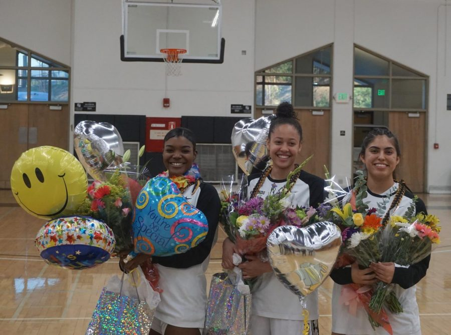 Rio Hondo sophomores Emily Mercedes, Destinee Garr and Maggie Lamas smile for friends, teammates and family before Friday night's matchup against Pasadena City.