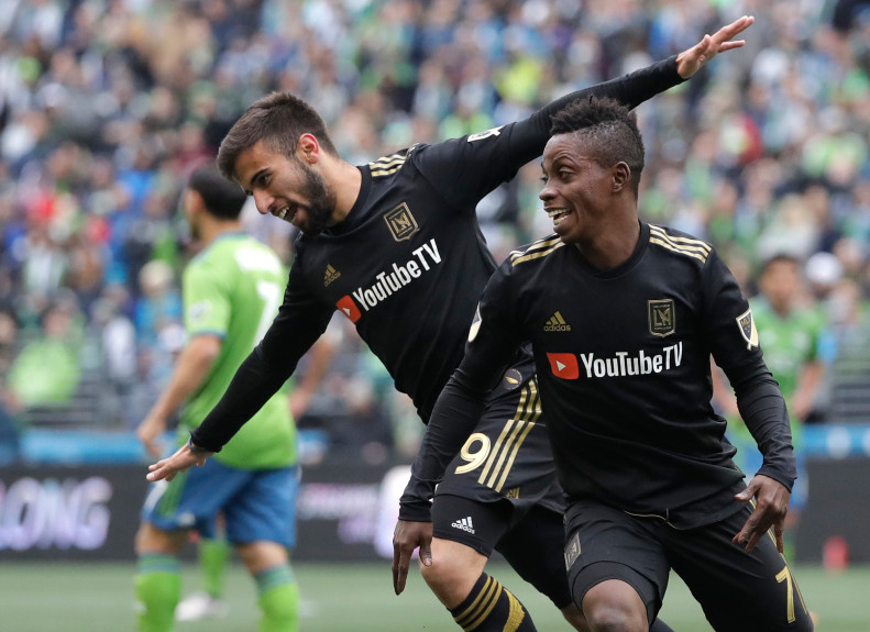 Los Angeles forward Diego Rossi, left, celebrates with Latif Blessing, right, after scoring a goal against the Seattle Sounders during the first half of an MLS soccer match, Sunday, March 4, 2018, in Seattle.(AP Photo/Ted S. Warren)