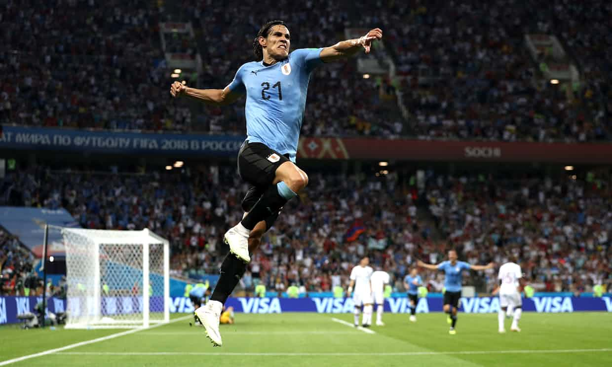 Edinson Cavani celebrates his second goal of the night that sent Uruguay to the quarter-finals. Photo credit: Patrick Smith, Getty Images