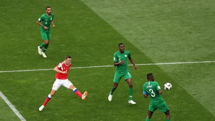 Russian winger Denis Cheryshev's (red) curling effort put the exclamation point on the host's dismantling of Saudi Arabia. Photo credit: foxsports.com
