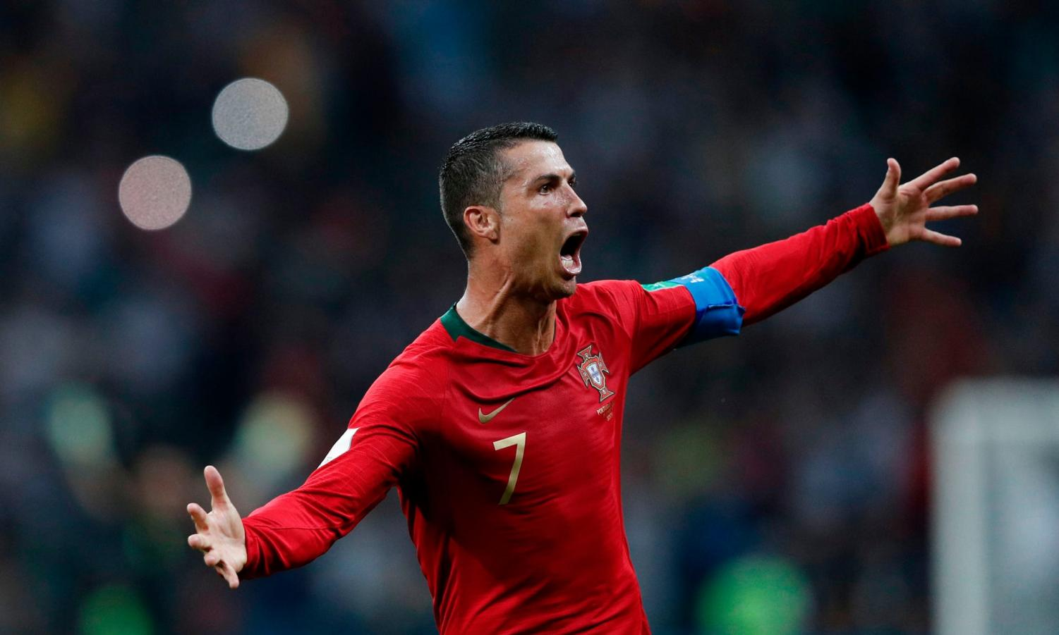 Ronaldo's hat trick sealed a share of the spoils for Portugal against rival Spain.