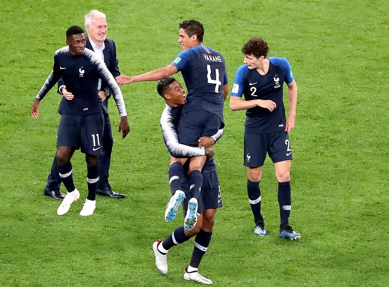 The French celebrate post-whistle after reaching the 2018 World Cup final. Photo credit: Zurab Kurtsikidze/EPA, via Shutterstock.