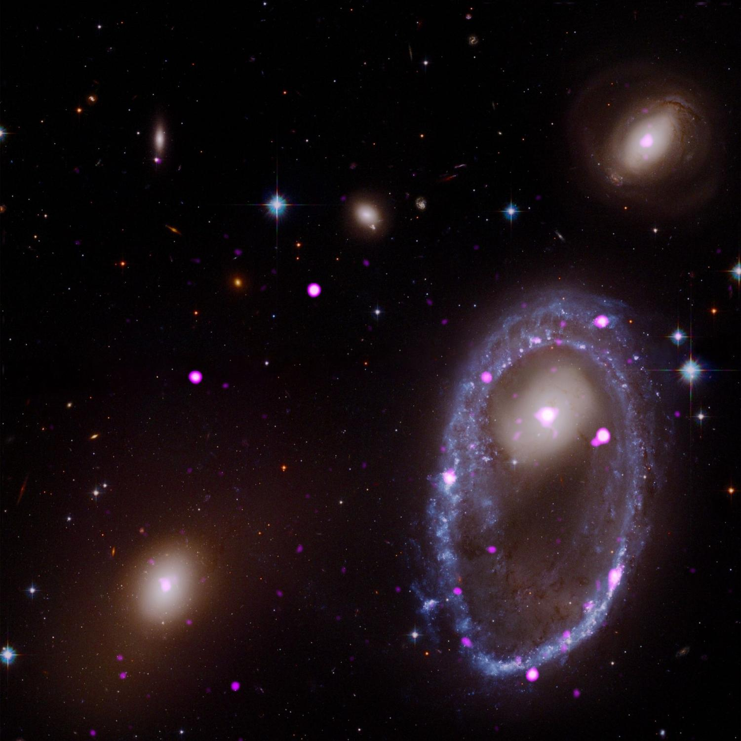 Image captured the X-rays by Hubble of the ring galaxy AM 0644 which is located in the lower right.