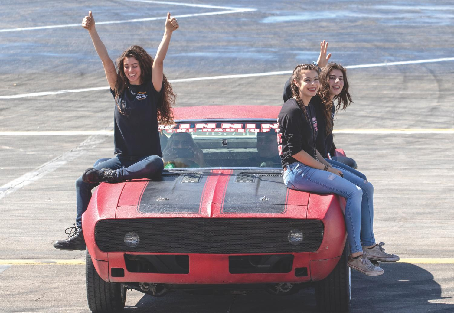 Stunt driver Sammy Maloof and his daughters perform in his 1967 Z28 Camero for students at Racing Against Bullying in Irwindale Speedway.
