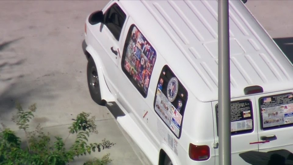 The pipe bomber's van decorated with pro-Trump posters.