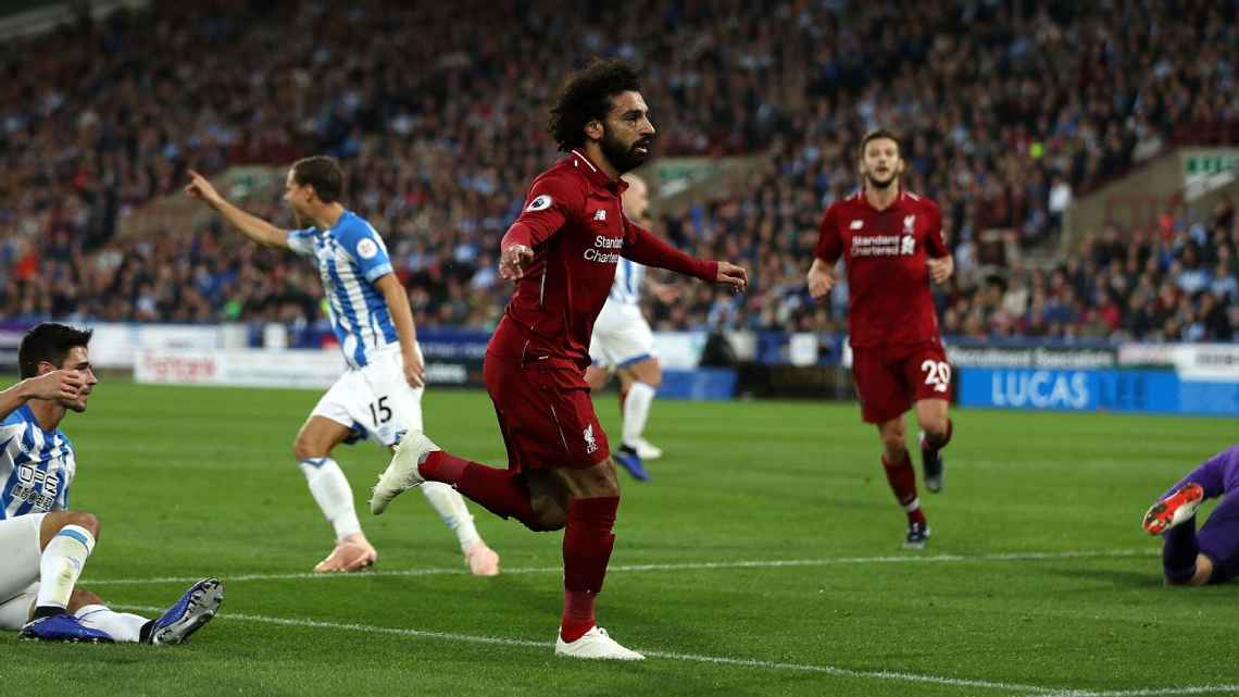 The Reds from Liverpool have scored 16 goals and have conceded just three in its first nine matches. Forward Mohamed Salah celebrates the team's latest against Huddersfield Town Saturday, Oct. 20 in a 1-0 road victory.