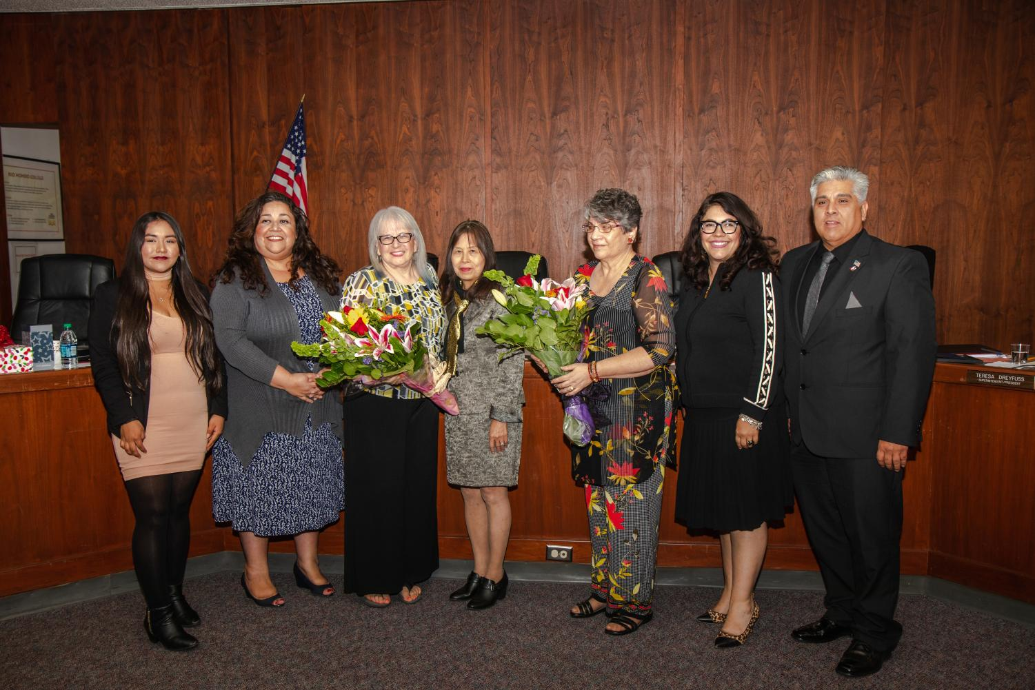 Board members Diana Laureano, Vicky Santana, Mary Ann Pacheco, School President Teresa Dreyfuss, and board members Norma  Edith Garcia and Gary Mendez pose for a picture during Shapiro's and Pacheco's last board meeting. (Photo by Brayan Altamirano)
