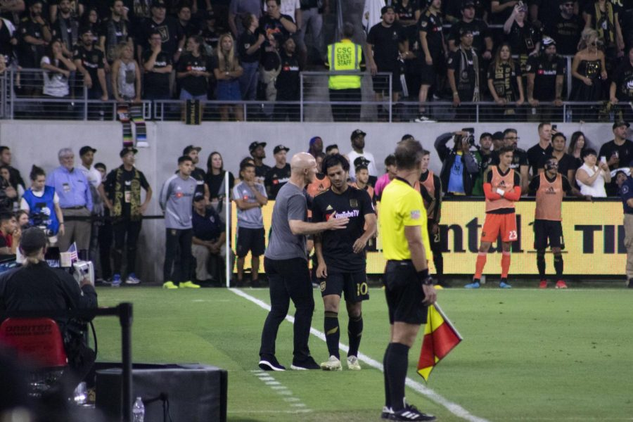 Vela walks out upset after being substituted by coach Bob Bradley due to a possible hamstring injury.
