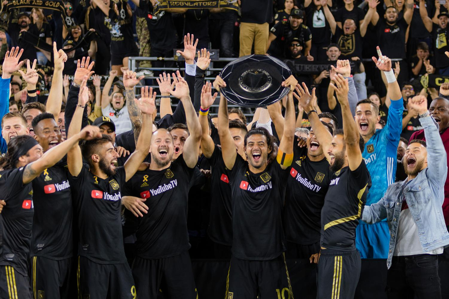 Captain Carlos Vela lifts the Supporters Shield for the very first time. It is the very first title for Los Angeles Football Club in only their second year in the league.