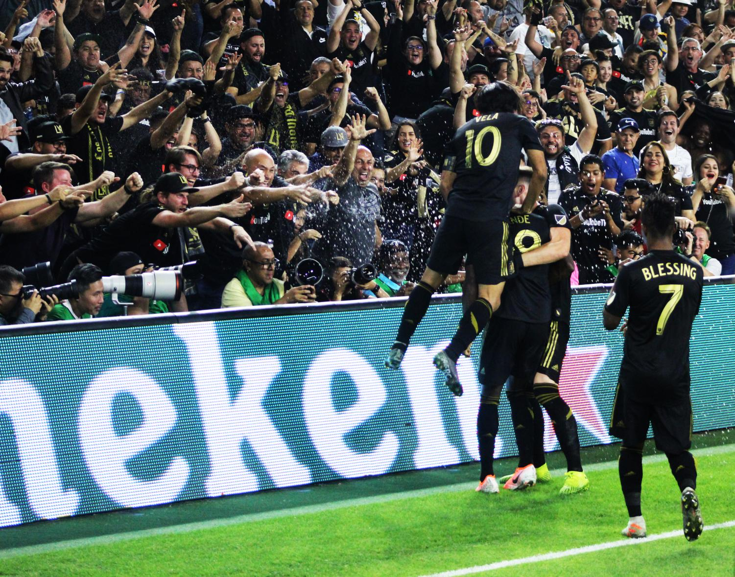LAFC fans celebrate at the Banc of California Stadium as forward Amade Diamande nets his brace. The black and gold grabbed their first playoff win against the LA Galaxy on Thursday night with a score of 5-3