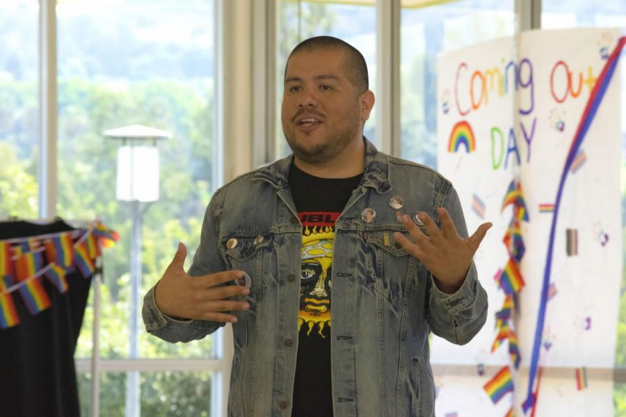 Julio Salgado answers questions from students after his lecture, Im a Queer Artist of Color and Im still Alive.