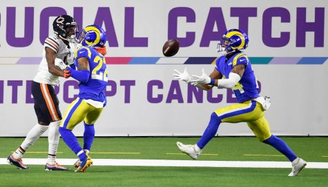 Rams defensive back Troy Hill (22) breaks up a pass intended for Bears receiver Darnell Mooney (11). Fellow Rams defender Taylor Rapp (24) hauls in the interception. The Rams