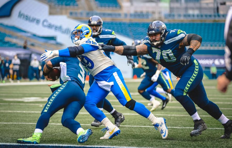 With Seattle backed up to their own 10 yard line, quarterback Russell Wilson (3) gets taken down by Aaron Donald (99) for a  nine yard loss. In three games versus the Seahawks this season, the Rams have sacked Wilson 16 times. In fifteen games against Wilson, Donald has 15 sacks. The Rams advance to the Divisional Round with their 30-20 victory over the Seahawks.