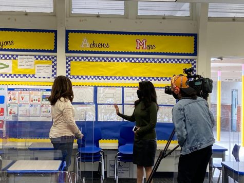 East Whittier Administrator showing a news crew precautions Laurel Elementary School will be taking to keep faculty and students safe.