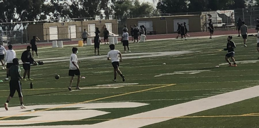 Students practicing soccer and football at Schurr High School in Montebello.