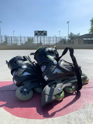 """Raymond takes his rollerblades to an empty hockey rink to practice """"falling with style."""""""