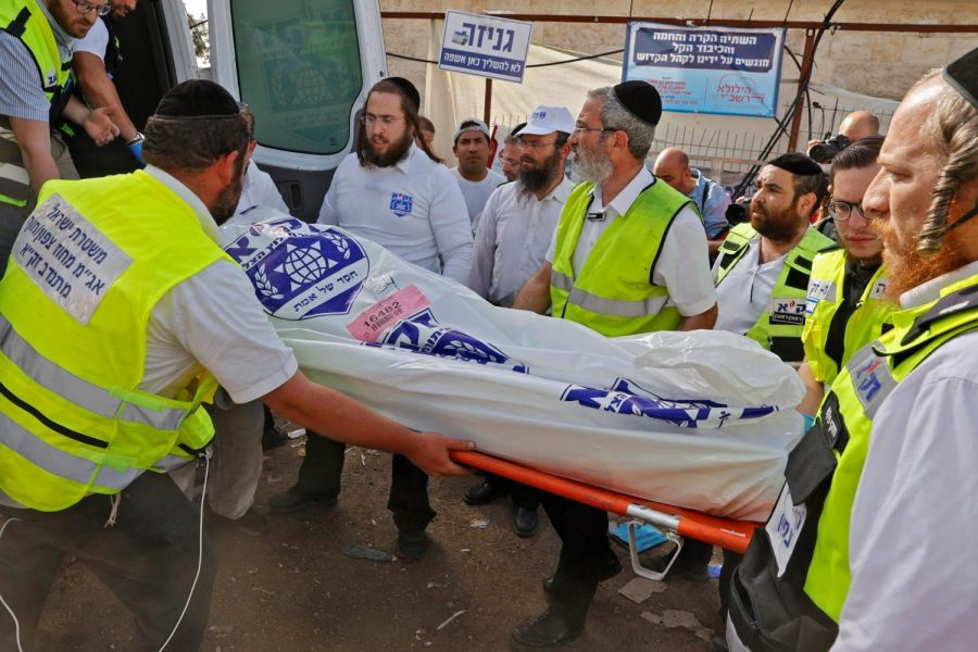 Medics in Israel helping clean up the bodies after the disaster of the celebration.